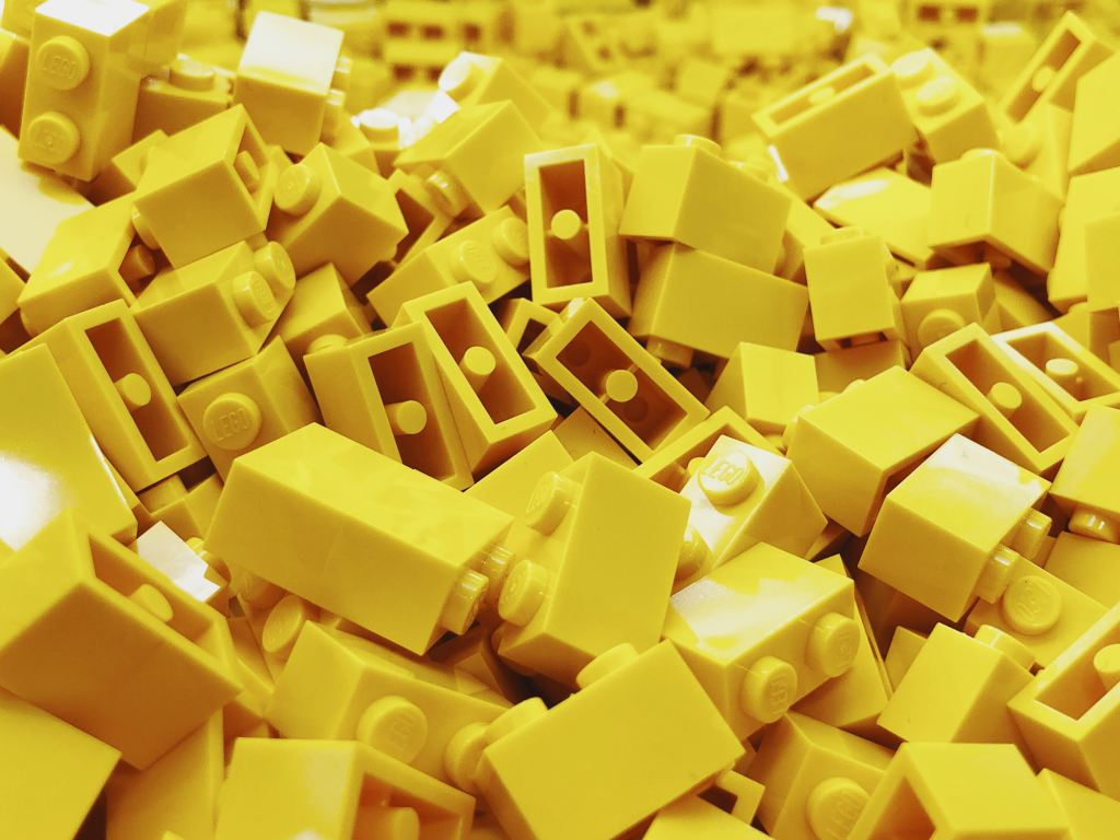 A Pile of yellow plastic building blocks